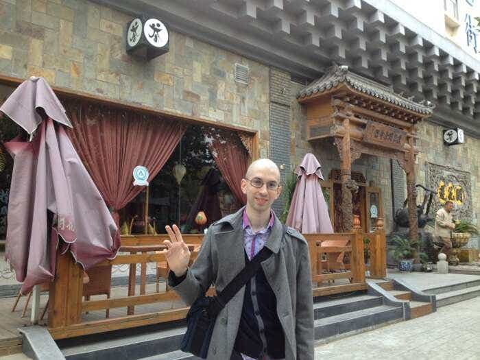 David in front of a Qingdao Teahouse