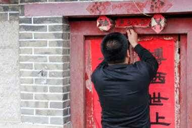 Mr He opens the gate to the local Taoist temple in Laoshan
