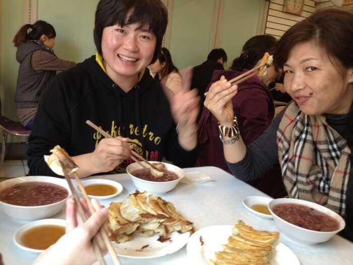 Weiwei and Wang enjoying potstickers