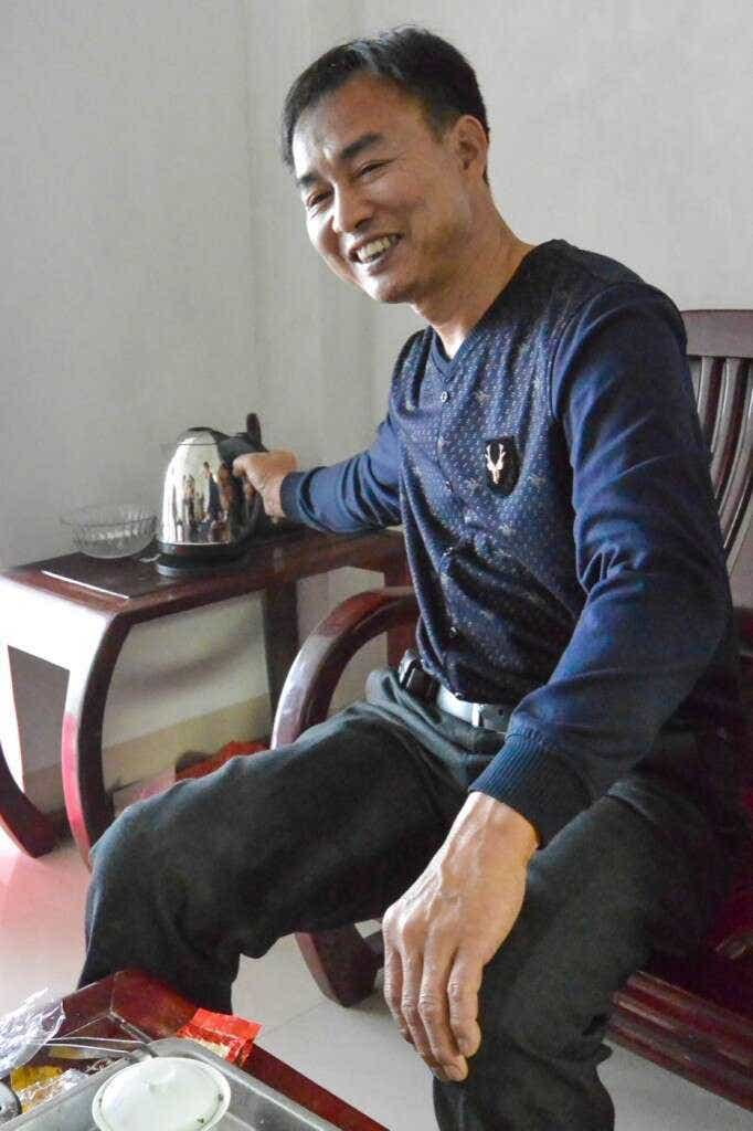 Master Zhang brews tea at his family home in Daping