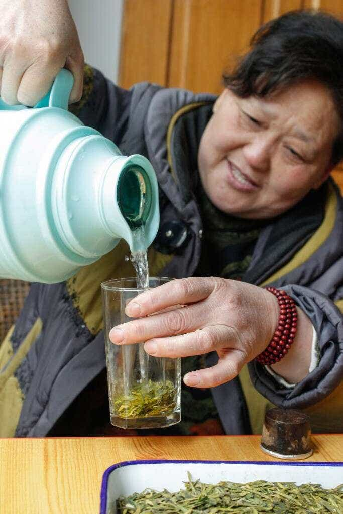 Mrs. Li brews her Dragonwell at home
