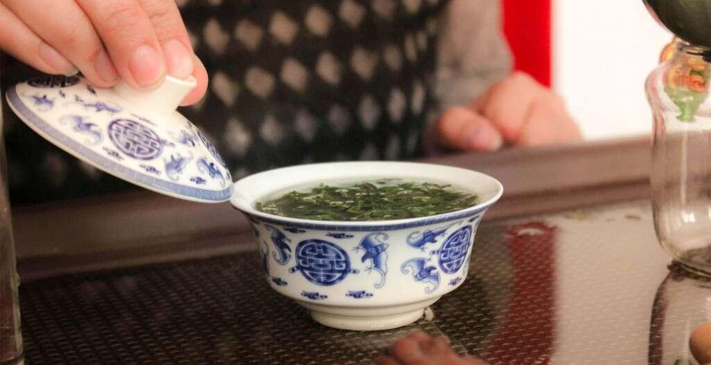 Qing Qing brews Flat Pressed Laoshan green at the shop in Laoshan