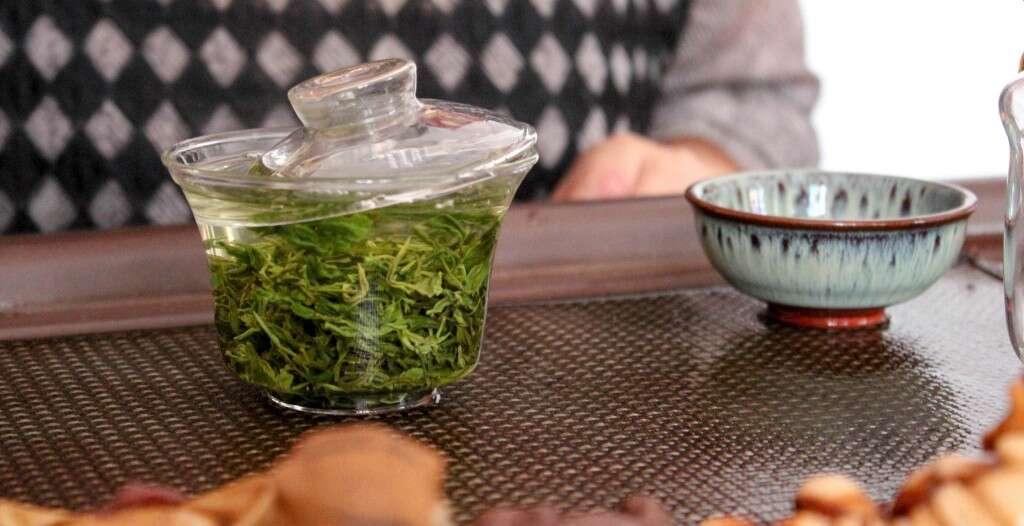 Qing Qing brews Laoshan Green at the shop in Laoshan