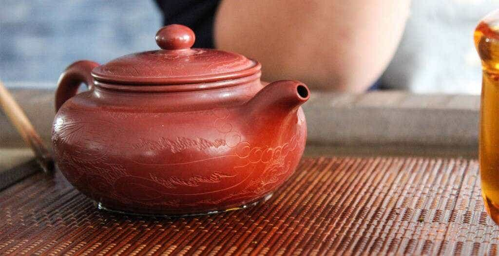 He Qing Qing brews her favorite tea - Laoshan Black - in a dedicated yixing tea pot