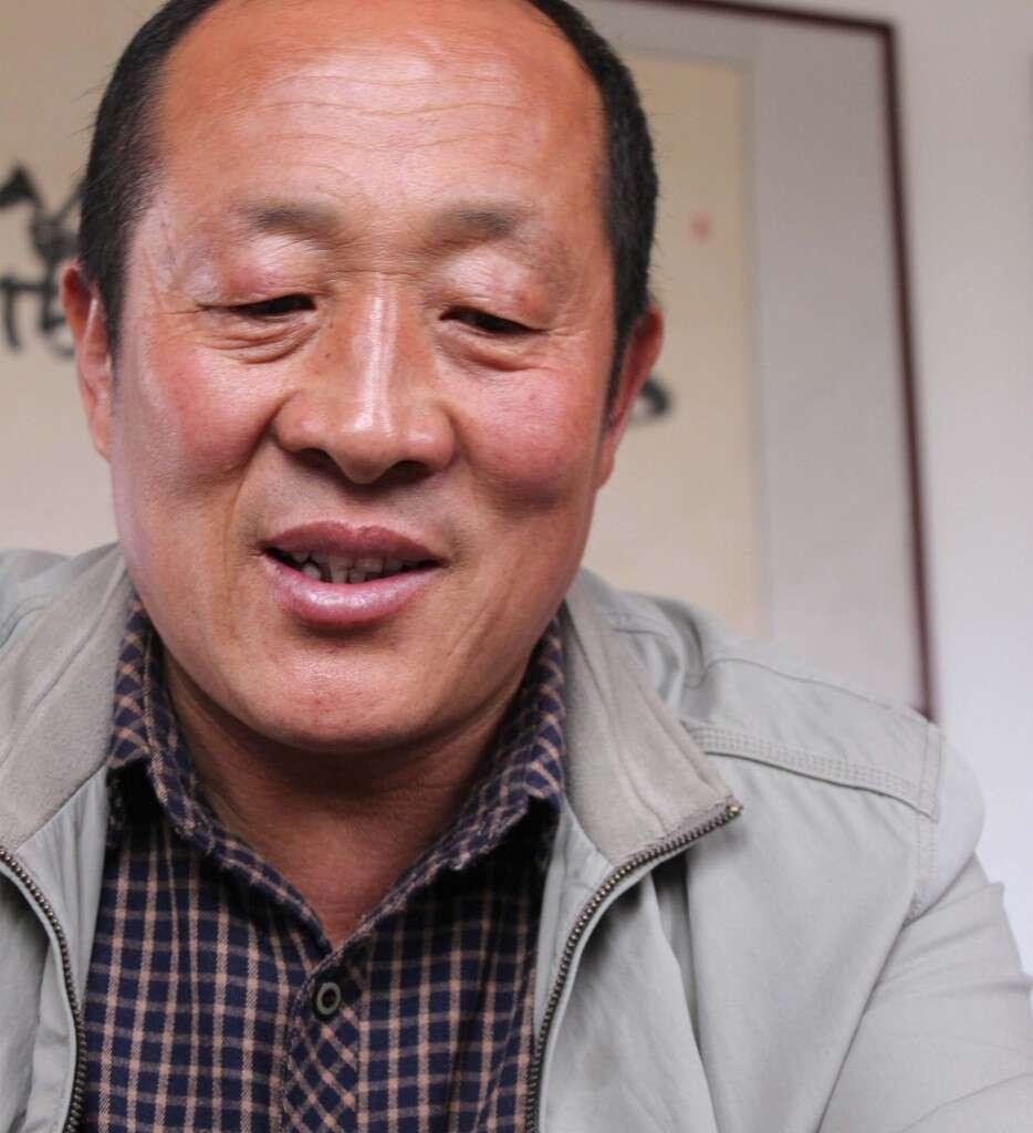 Mr. He, our mentor and tea farmer partner in Laoshan Village