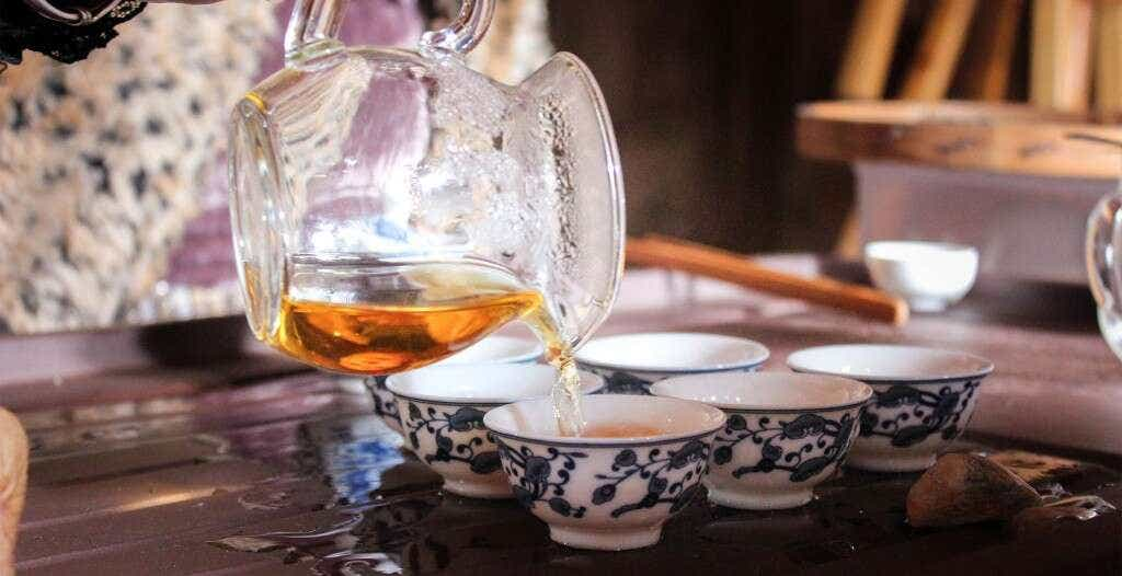 Li XIangxi brews tea at her family's Tongmu home and workshop