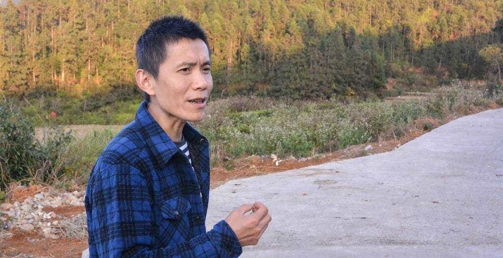 Mr. Li, Li Xiangxi's brother, in the hills above his family's oolong workshop