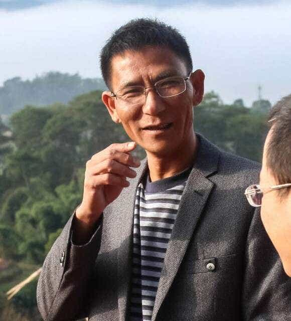 Master-Zhou-portrait-1185x1308