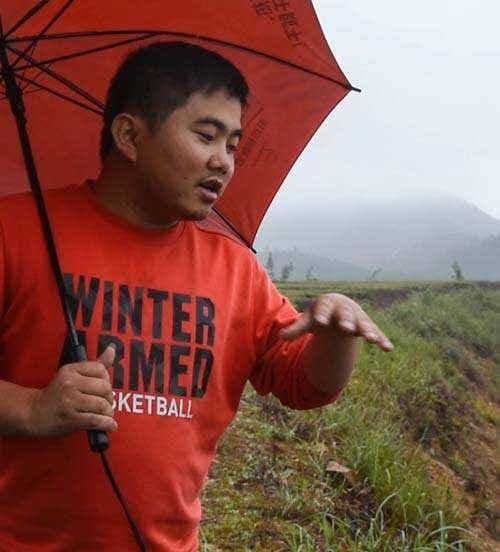 Mr. Liu talks about his family's tea fields