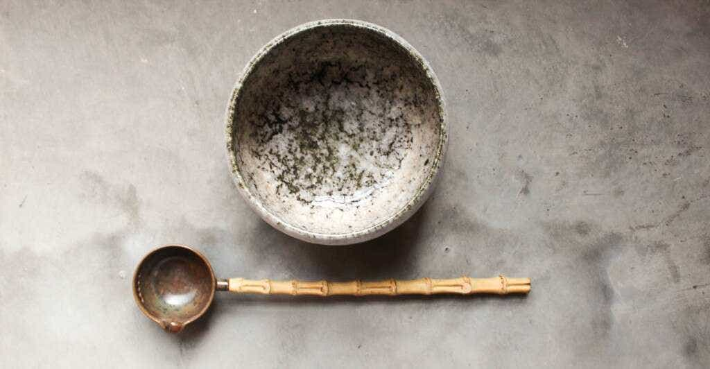 a simple tea bowl and ladle for Dian Cha ceremony
