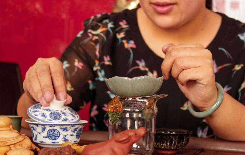 He Qing Qing brews her family's Pine Needle Green tea