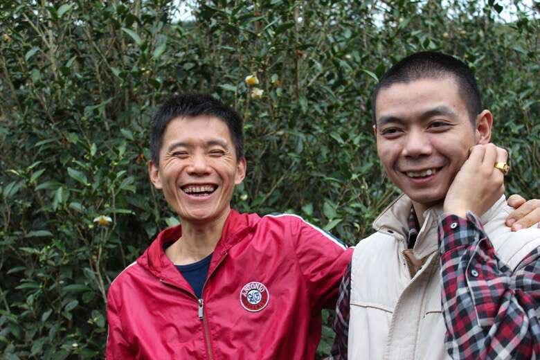 Li Xiangxi's brother (left) poses with Jun Jun (right