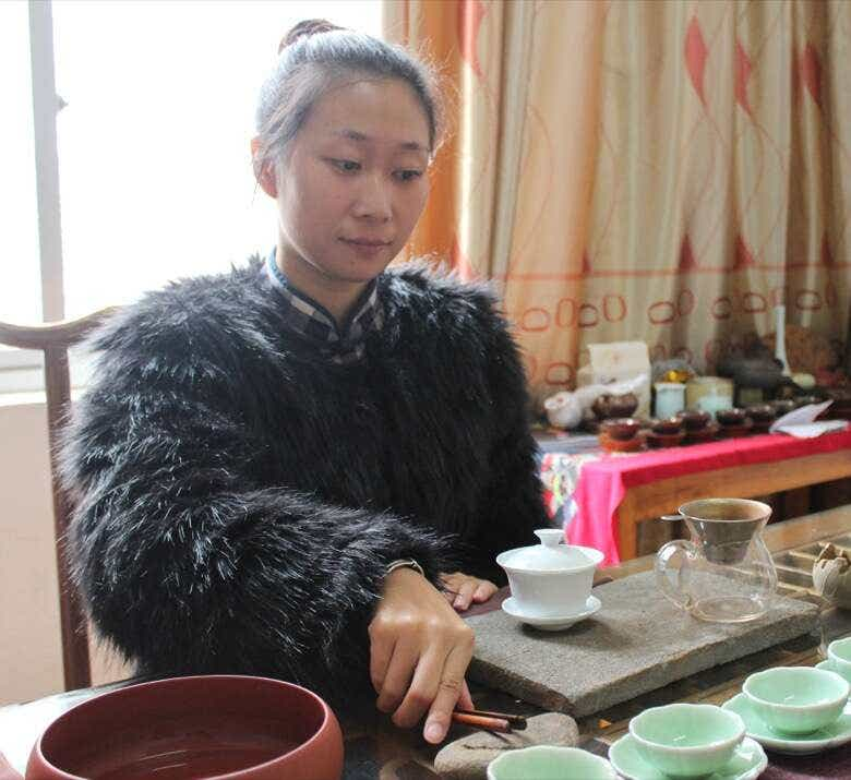 Li Xiangxi prepares to brew her family's tea