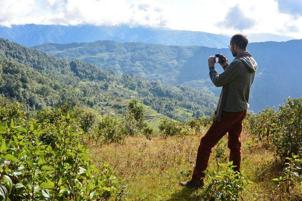 Verdant Tea's David Duckler taking in the view of wild forest interspersed with terraced walnut groves