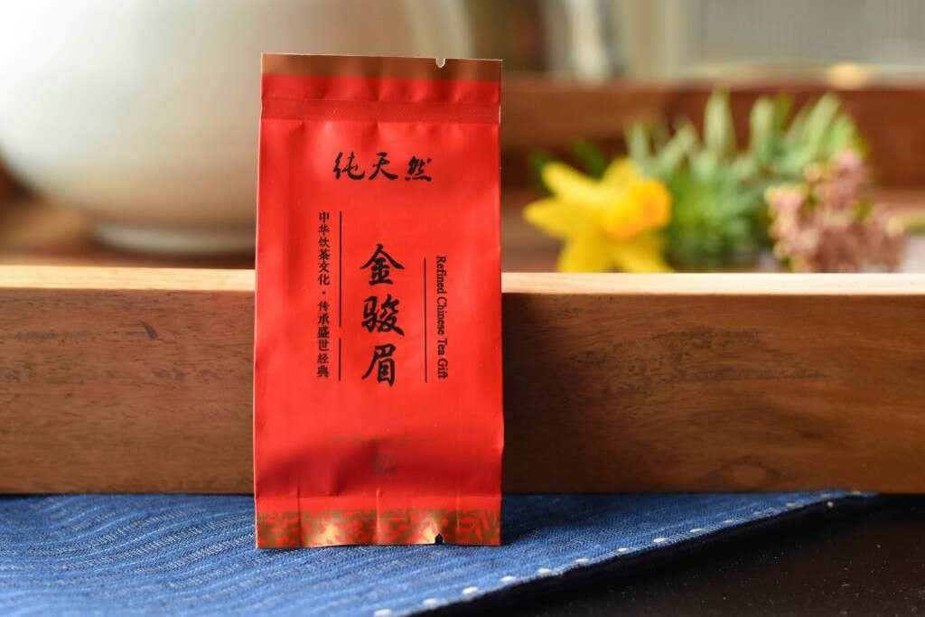 The Liu family's Tieguanyin Jin Jun Mei is pre-packed into individual 5g portions of tea.