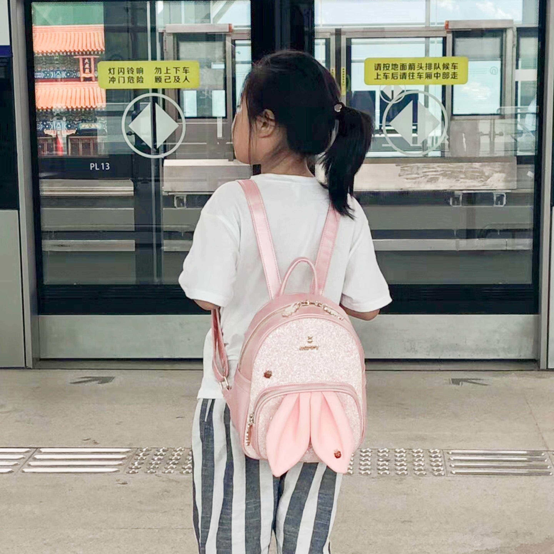 Niu Niu waits to ride the subway for the first time.