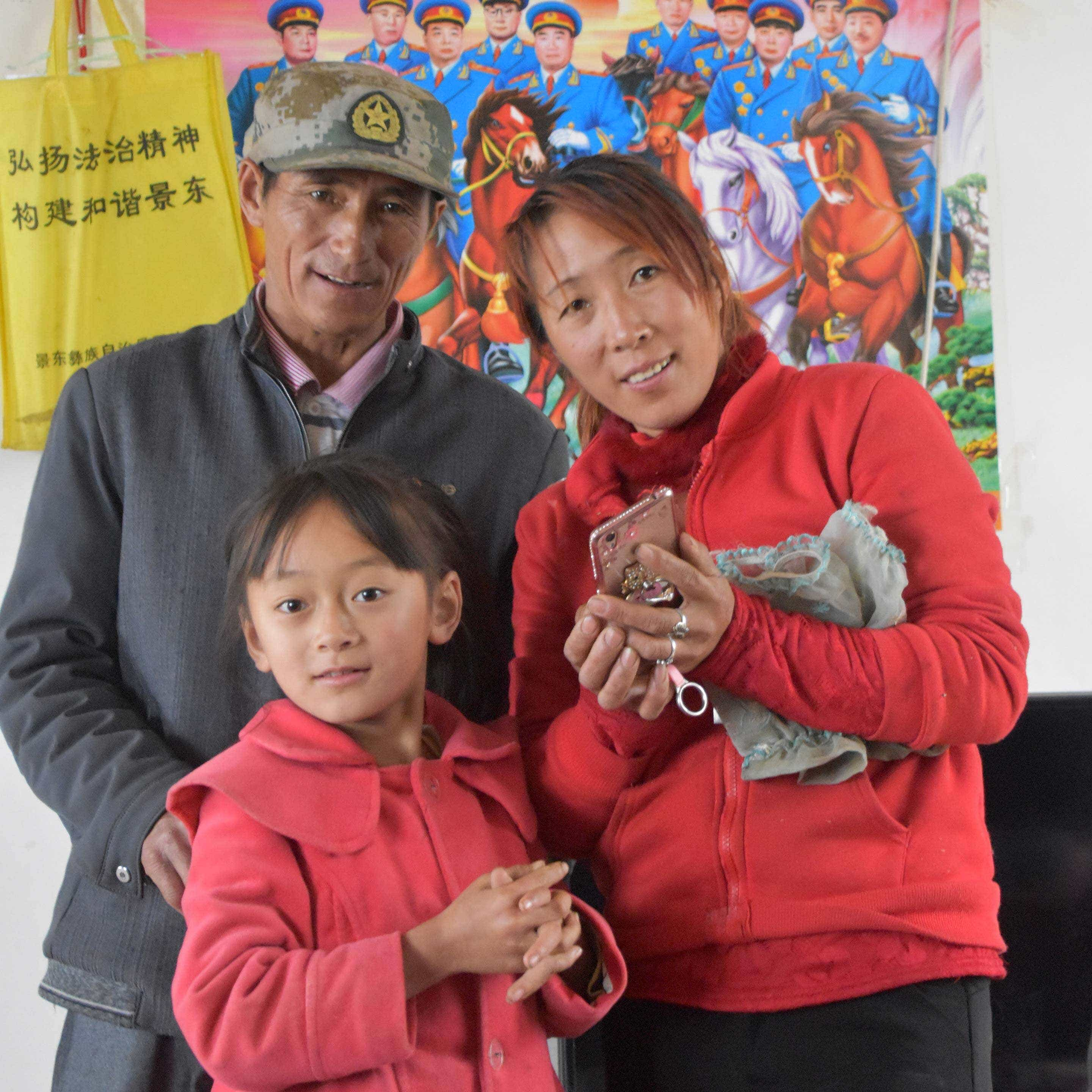 Mr. Li with his daughter and granddaughter