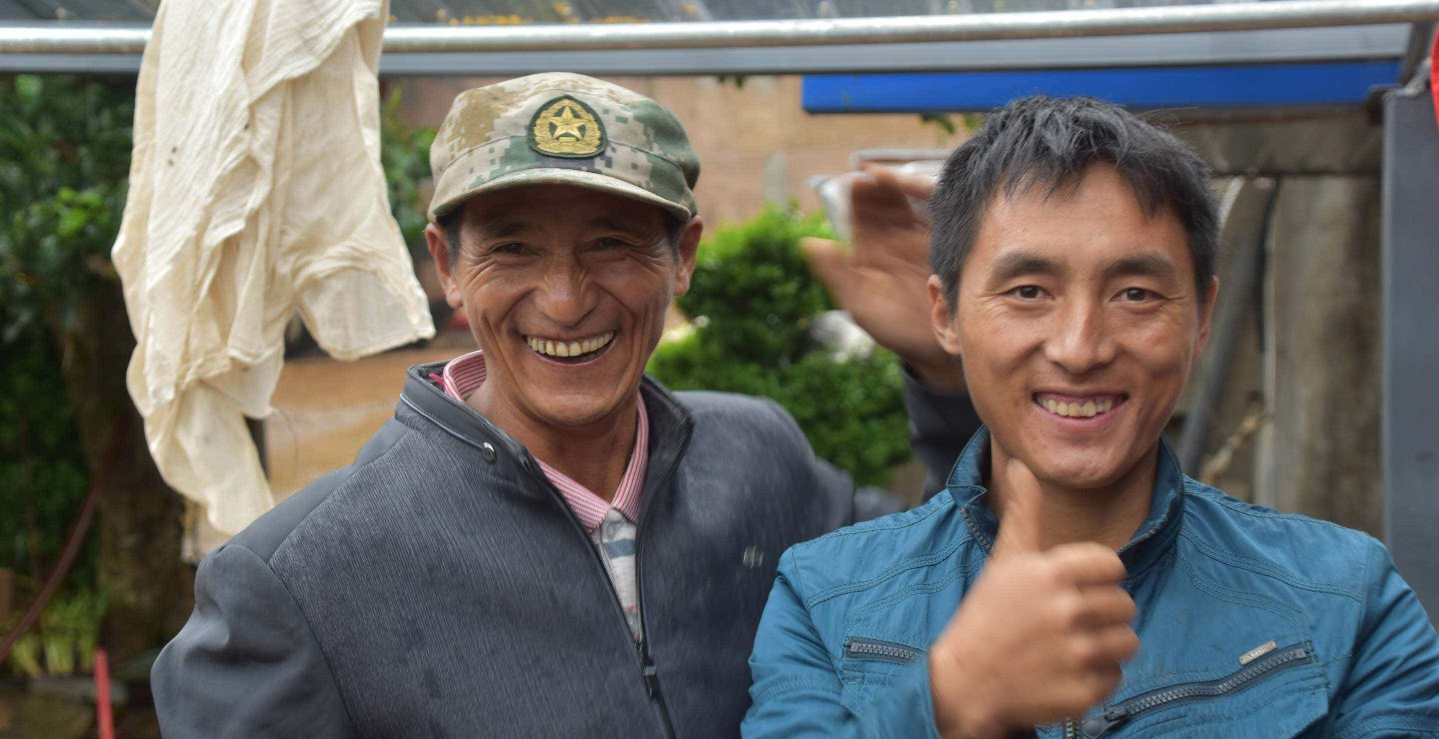 """Mr. Li and his son say """"hello"""" from their workshop in Qianjiazhai!"""