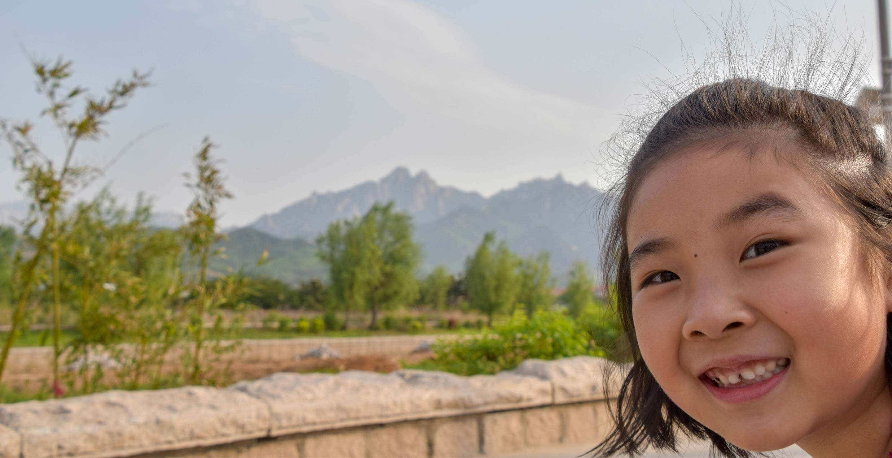 our family lives in Laoshan Village between the beautiful mountains and the ocean